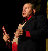 Queerios! Cast Member Rev. James Laljer as Criminologist at The Rocky Horror Picture Show - Austin, Texas